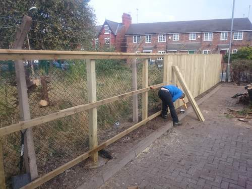 Danny building a feather edge fence